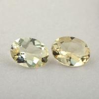 Пара золотистых бериллов гелиодоров формы овал, общий вес 1.89 карат, размер 8.1х6.2мм (beryl0257)