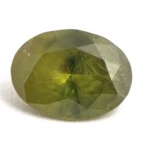 Желтовато-зелёный уральский демантоид овал, вес 0.86 карат, размер 7.2х5.3мм (dem0037)