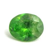 Светло-зелёный уральский демантоид овал, вес 0.46 карат, размер 5.5х4.5мм (dem0039)