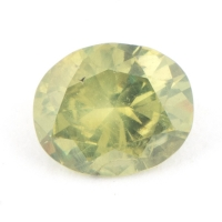 Жёлто-зелёный уральский демантоид формы овал, вес 0,65 карат, размер 6х5мм (dem0044)