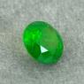 Уральский гранат демантоид формы круг, вес 0.53 карат, размер 4.9х4.9мм (dem0063)