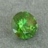 Уральский гранат демантоид формы круг, вес 0.69 карат, размер 5.2х5.2мм (dem0064)