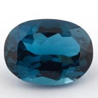 Голубой топаз лондонского оттенка формы овал, вес 24.29 карат, размер 20х15мм (london0108)
