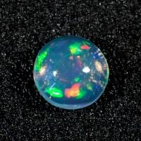 Эфиопский опал кабошон круг вес 0.78 карат, размер 7х7мм (opal0465)