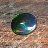 Черный эфиопский опал овал вес 1.56 карат, размер 9.7х7.7мм (opal0521)