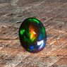 Черный эфиопский опал овал вес 1.1 карат, размер 9.3х7.1мм (opal0522)