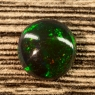 Черный эфиопский опал круг вес 1.43 карат, размер 9.6х9.2мм (opal0628)