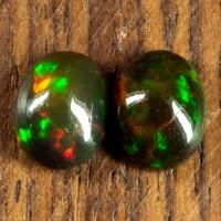 Пара черных опалов формы овал, общий вес 2.71 карат, размер 9.1х7.2мм (opal0680)