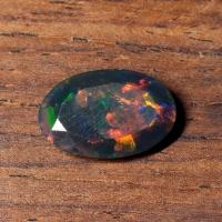 Черный эфиопский опал овал вес 1.6 карат, размер 12.5х8.2мм (opal0685)
