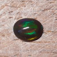 Черный эфиопский опал овал вес 1.16 карат, размер 8.9х6.9мм (opal0731)