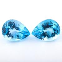 Пара голубых топазов формы груша, общий вес 69.25 карат, размер 24.2х18.3мм (sky0134)