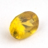 Золотистый сфен овал вес 0.6 карат, размер 5.9х4.2мм (sphene0055)