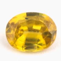 Золотистый сфен овал вес 0.84 карат, размер 6.8х5.3мм (sphene0057)