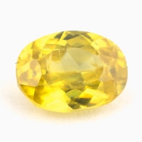 Золотистый сфен овал вес 0.79 карат, размер 6.4х4.7мм (sphene0058)