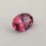 Оранжево-розовая шпинель отличной российской огранки формы овал, вес 0.49 карат, размер 6.1х4.3мм (spinel0269)