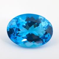 Ярко-голубой топаз овал, вес 33.37 карат, размер 24.07х17.6мм (swiss0038)