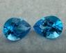Пара ярко-голубых топазов отличной российской огранки формы груша, общий вес 34 карат, размер 19.8х14.6мм (swiss0046)