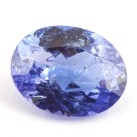 Яркий фиолетово-синий танзанит с включениями овал, вес 2.42 карат, размер 9.9х7.6мм (tanz0214)
