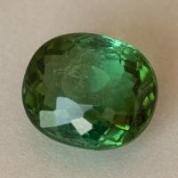 Зеленый турмалин формы овал, вес 6.52 карат, размер 11.8х10.1мм (turm0570)